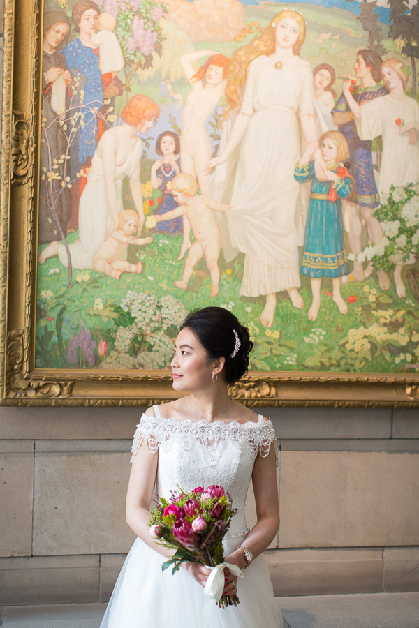 bride with flowers during photo shoot