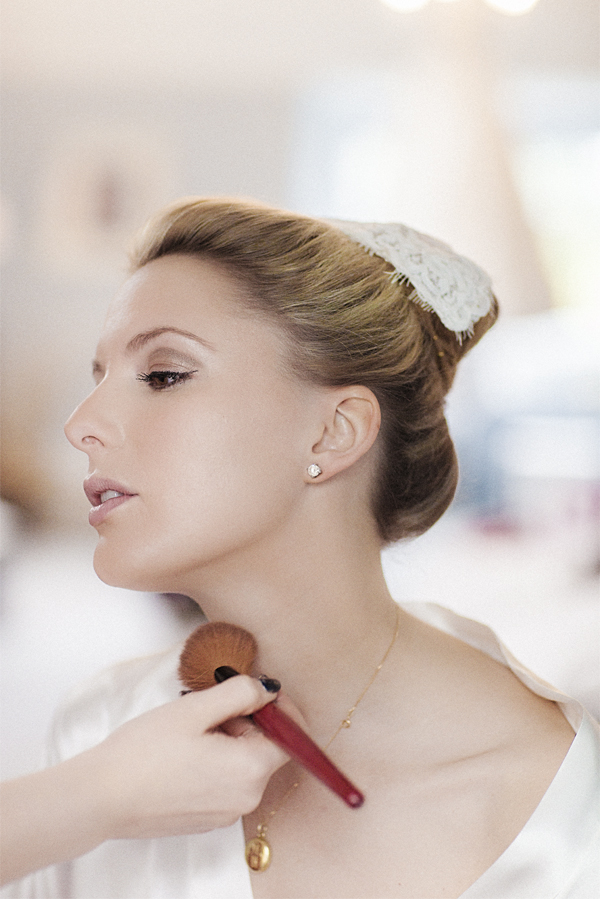 bride having her makup done with italian hair piece