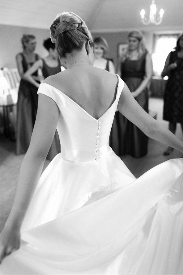 bride spreading her dress