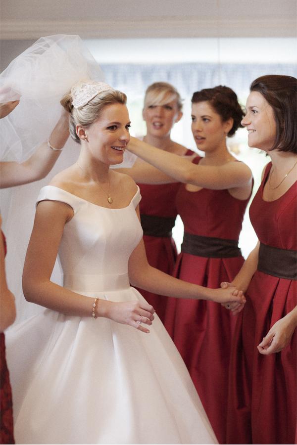 bridesmates helping to fix bride