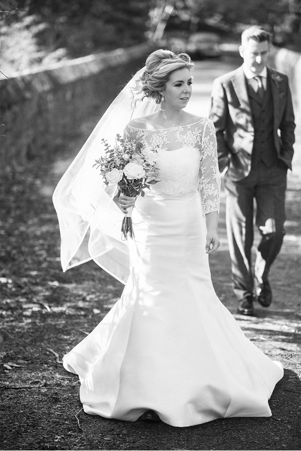 bride walking away at a bridge at stonefield castle