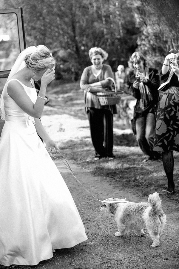 bride with her dog outside church