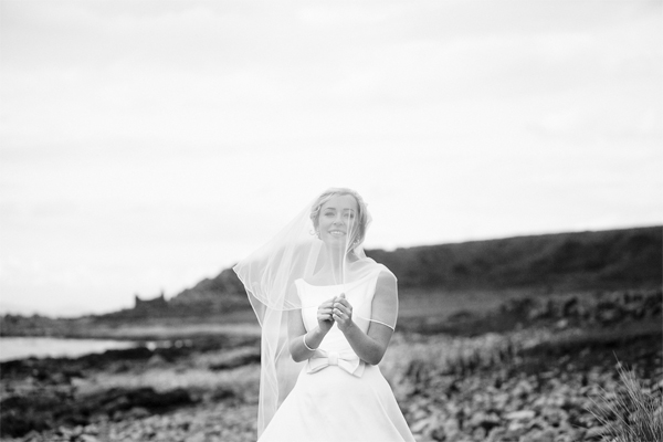 bride on a beach during wedding photo session