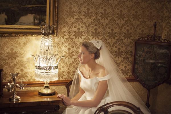 bride nxt to a vintage lamp