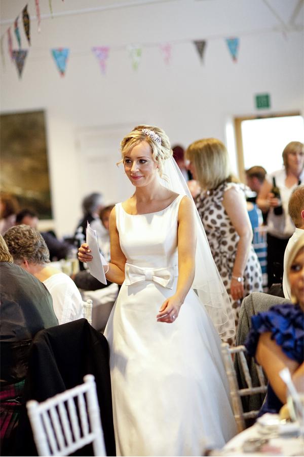 bride walking through tables