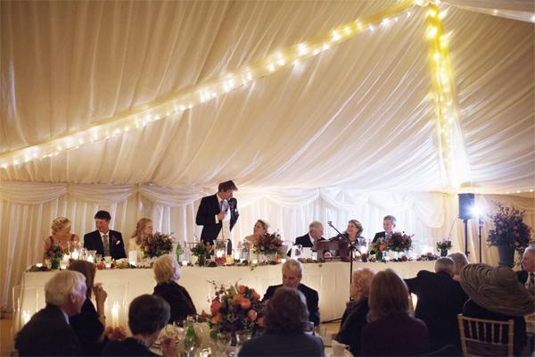 groom in speaking during wedding speeches