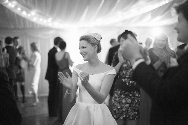 bride clapping after first few dances