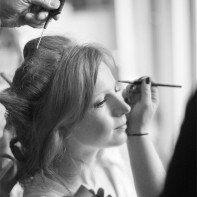 bride having make-up done preparatins for winter wedding at cameron house loch lomond scotland