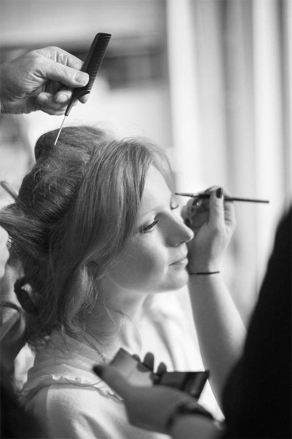 bride having make-up done preparatins for winter wedding at cameron house loch lomond scotland