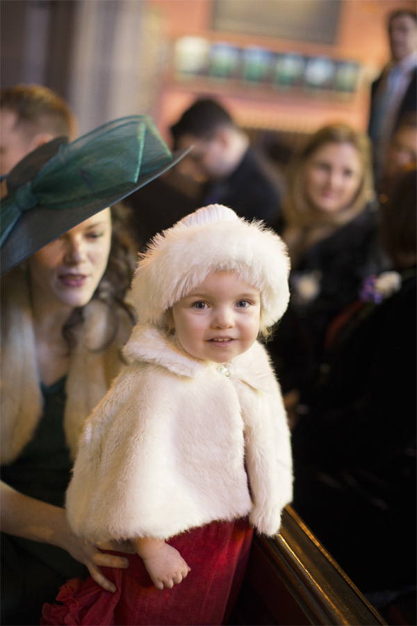 little girl in christmas outfit on a wedding in scotland