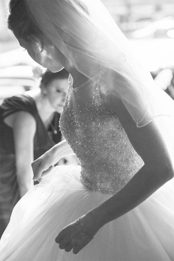 bride having her dress fixed