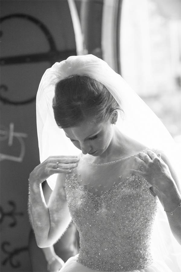 bride fixing her dress