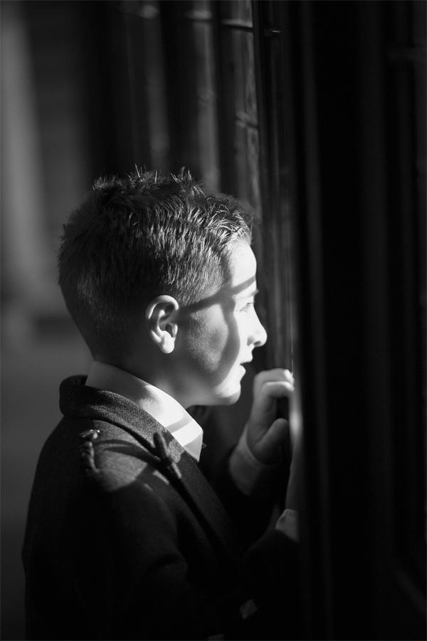 boy looking at bride through a window
