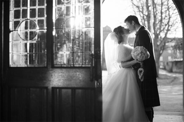 newlyweds kissing embraced