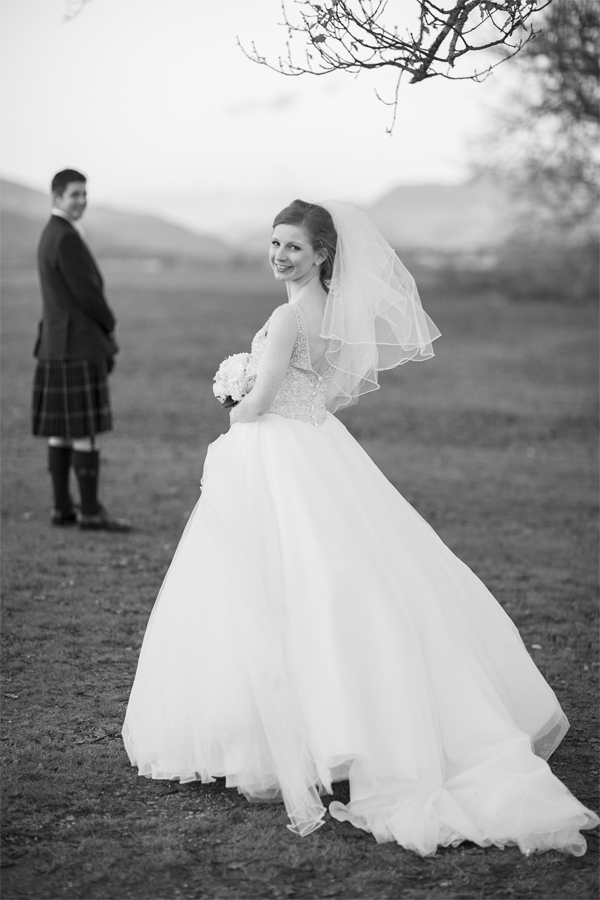 bride and groom standing at loch lomond