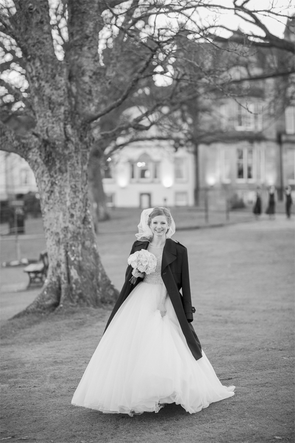 bride in a winter coat during wedding photo shoot