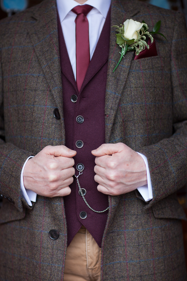 groom holding his suit the lodge on loch goil scotland