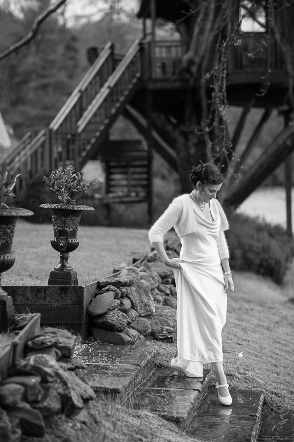 bride walking down stairs at the lodge on loch goil scotland