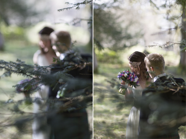 view through trees at bride and groom