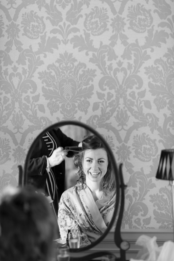 bride having her hair done during preparations at  blairquhan castle