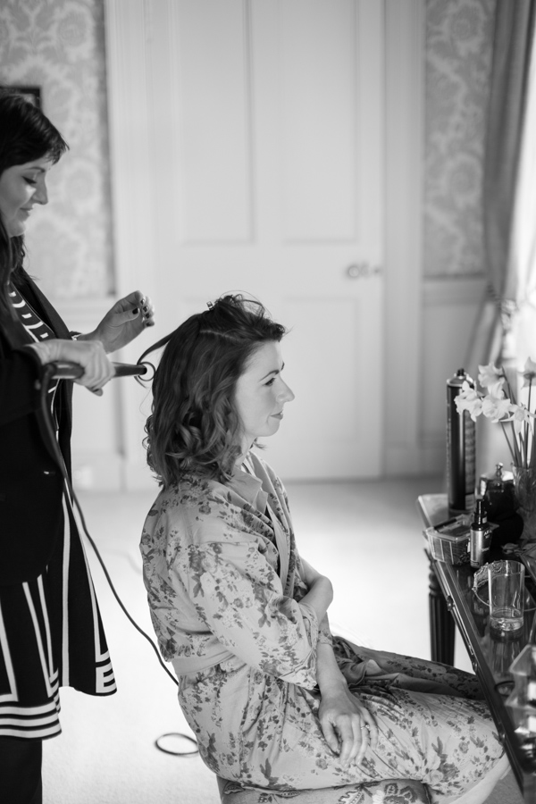 bride having her hair done at blairquhan castle
