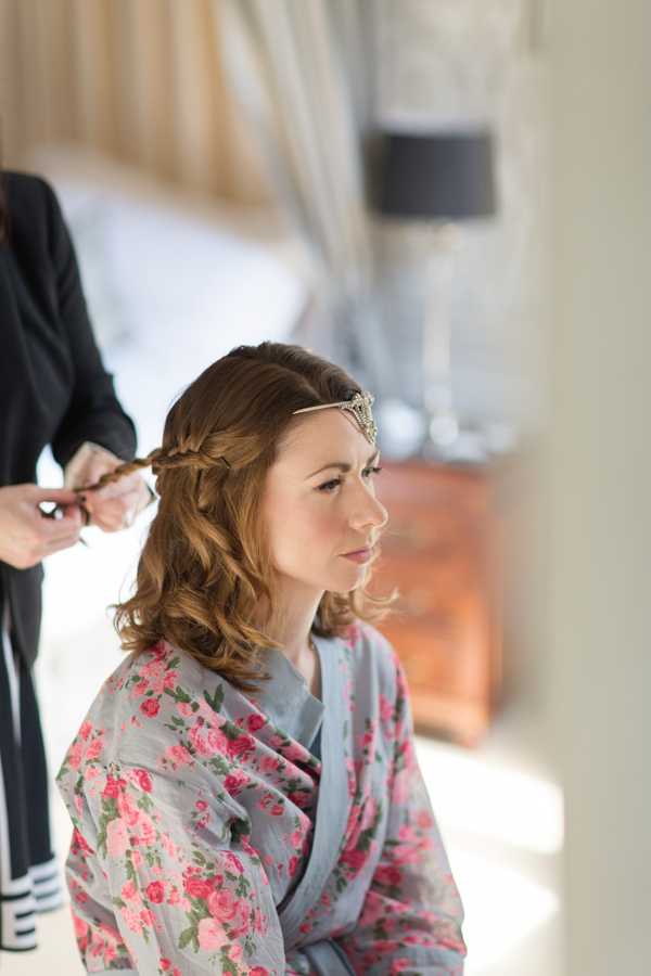 bride having her hair done and hair piece installed