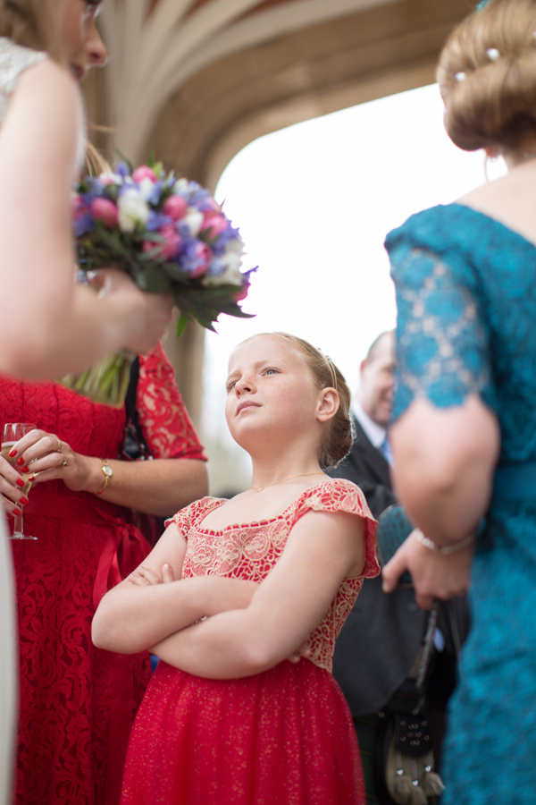 girl looking at bride reportage photographer glasgow
