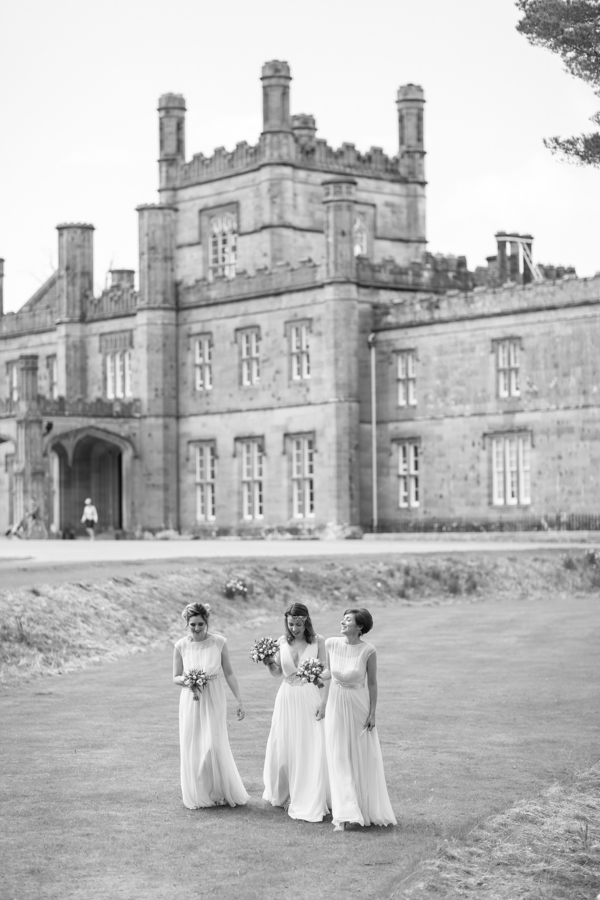 wedding photos bridesmates walking with Blairquhan Castle in the background