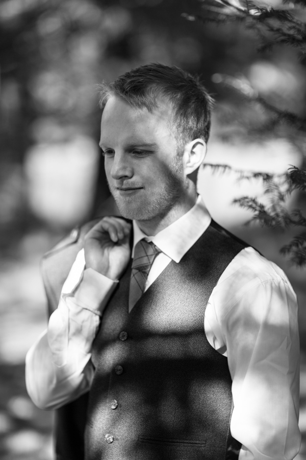 portrait of a groom in the gardens