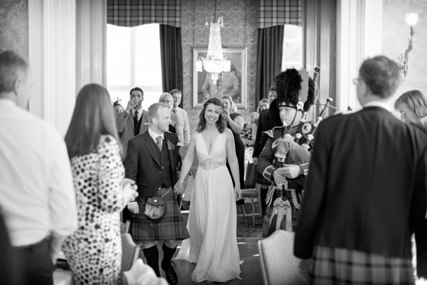 married couple piped in at Blairquhan Castle