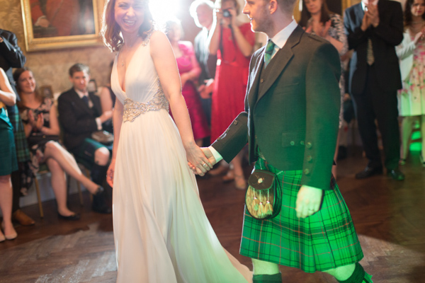 bride and groom walking into their first dance at Blairquhan Castle