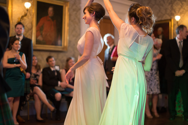 bridesmates dancing together on a wedding