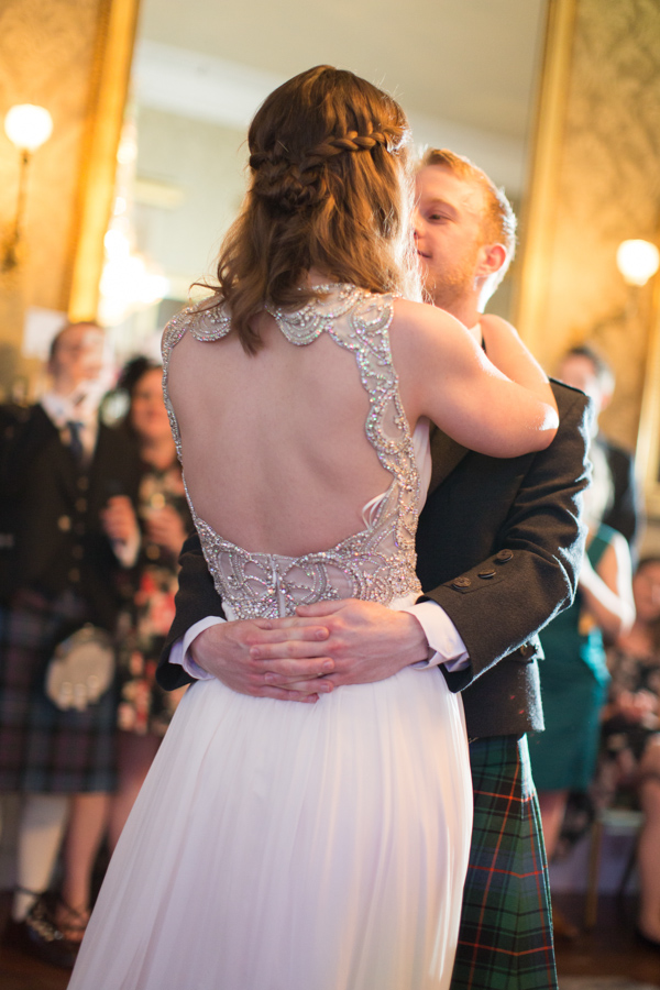 newlyweds embraced during first dance