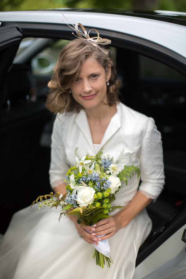 bride smiling getting out of the car