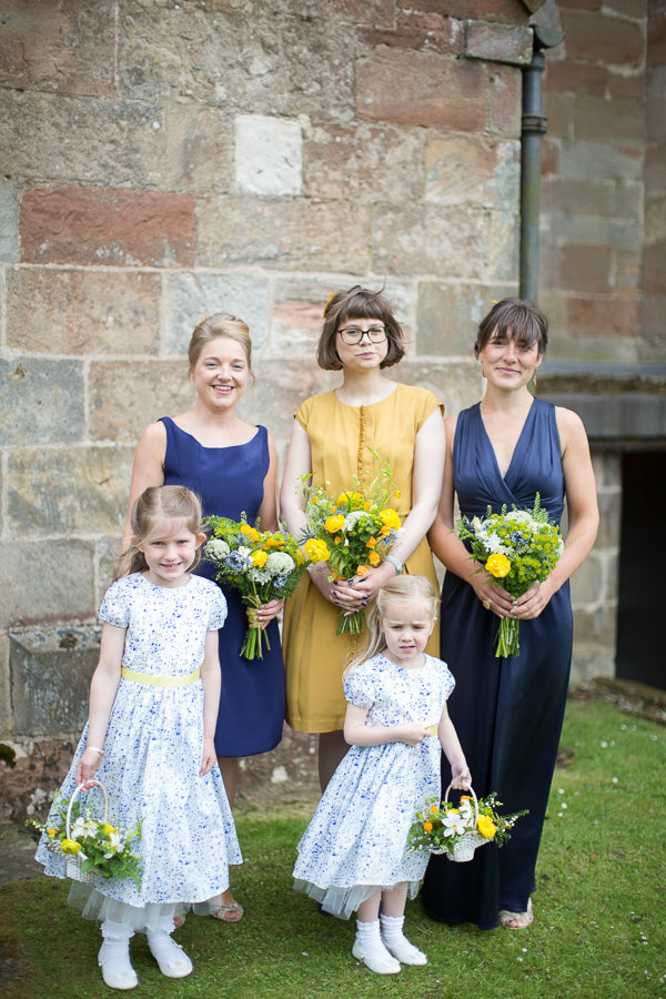 bridesmates and flowergirls at the church