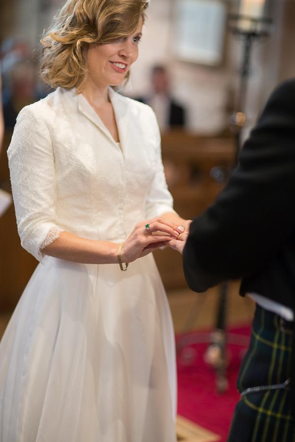 bride and groom exchanging wedding rings edinburgh scotland