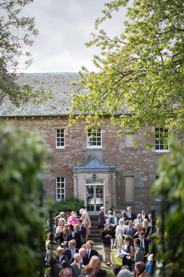 guests at wedding reception outsdie edinburgh