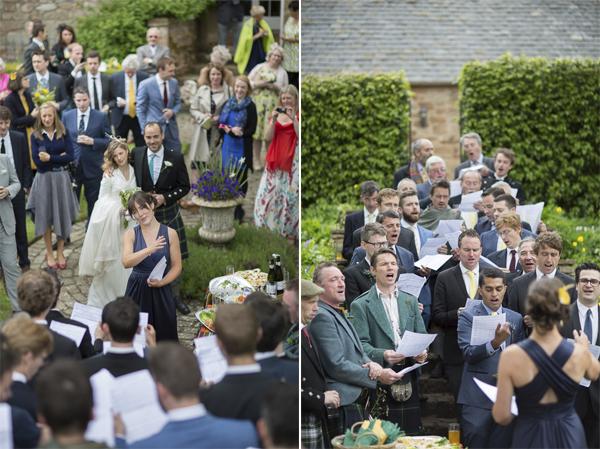 wedding guests singing in choir at wedding reception