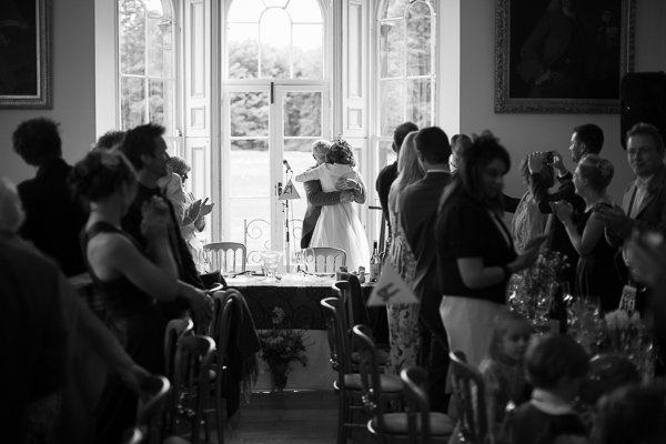 bride huging father at oxenford reception near edinburgh