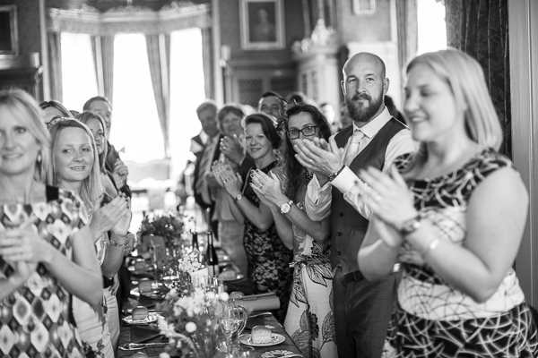 guests clapping looking at bride and groom