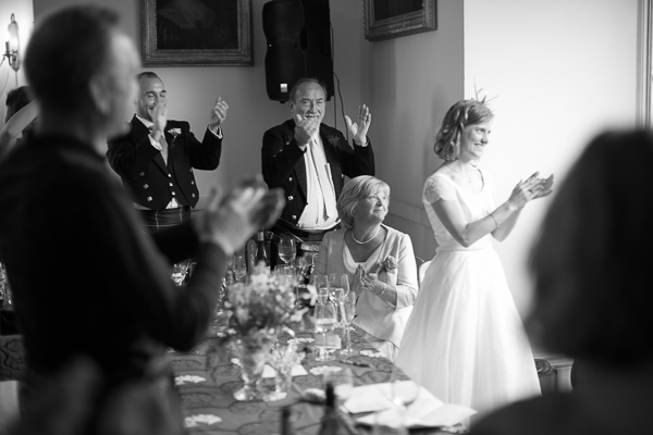bridal party clapping during speeches