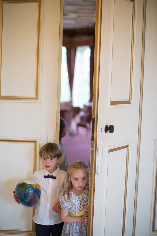 kids looking in from behoind closed doors
