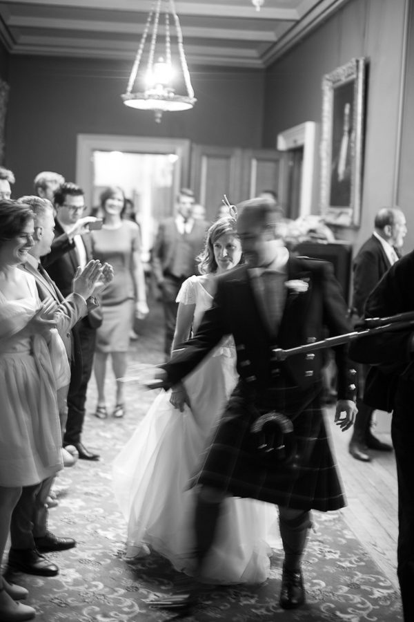 newlyweds walking in for cutting of the cake at oxenford castle