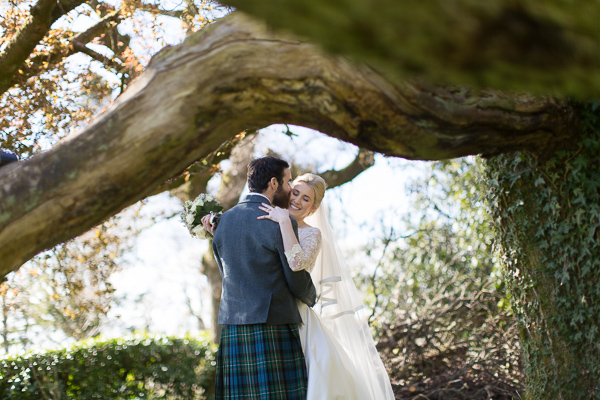 married couple embraced wedding photos loch lomond