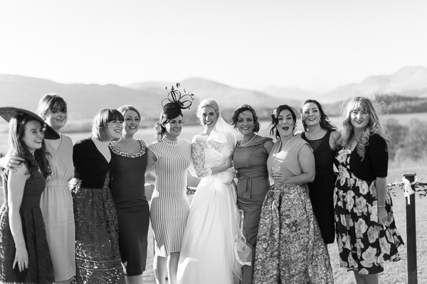 bride with her girlfriends laughing