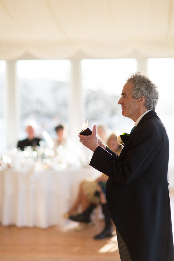 father doing a magic trick during his speech