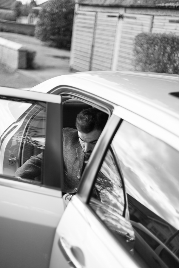 groom getting into a car