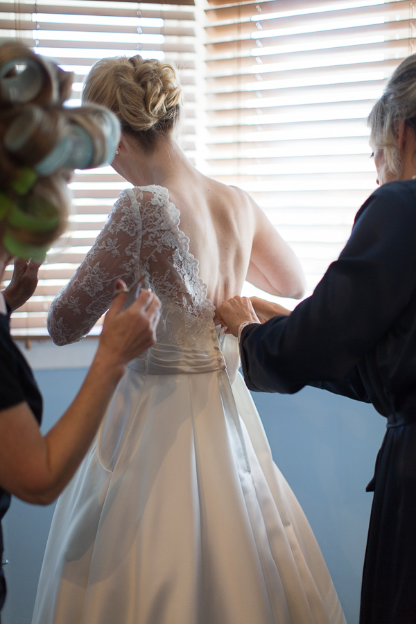 bride putting her dress