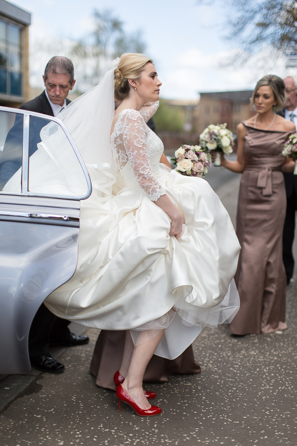 bride getting out of a car