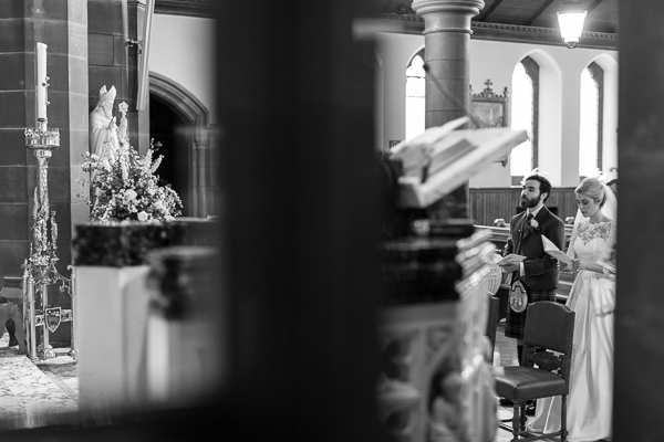 bride and groom singing in church